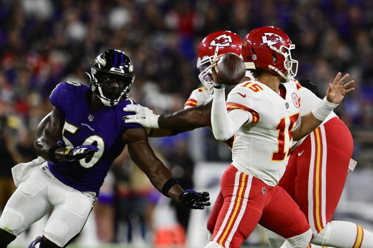 Kansas City Chiefs quarterback Patrick Mahomes (15) throws as Baltimore Ravens linebacker Justin Houston (50) rushes during the first half at M&T Bank Stadium.