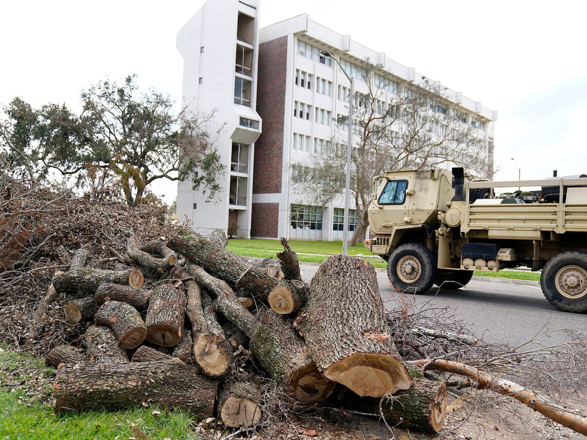 A National Guard vehicle makes its way through the campus of Nicholls State University.