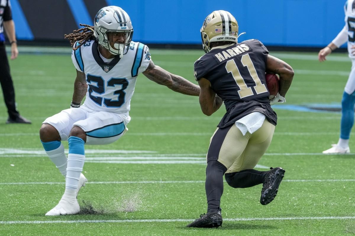 New Orleans Saints wide receiver Deonte Harris (11) tries to elude Carolina cornerback Stantley Thomas-Oliver III (23). Mandatory Credit: Jim Dedmon-USA TODAY Sports