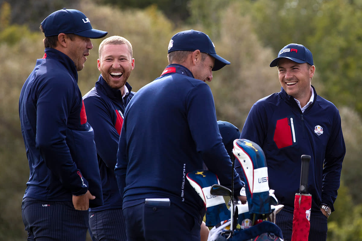 Brooks Koepka, Daniel Berger and Jordan Spieth laugh together Wednesday.