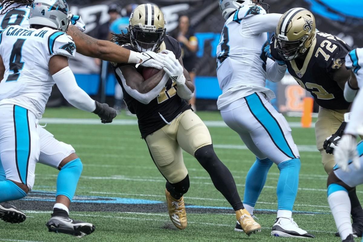 Carolina defensive tackle Bravvion Roy (93) stops New Orleans Saints running back Alvin Kamara (41). Mandatory Credit: Jim Dedmon-USA TODAY Sports