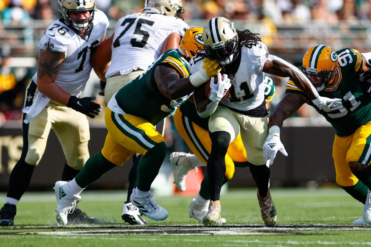 New Orleans Saints running back Alvin Kamara (41) carries the ball as Green Bay tackle Kenny Clark (97) defends. Mandatory Credit: Nathan Ray Seebeck-USA TODAY Sports