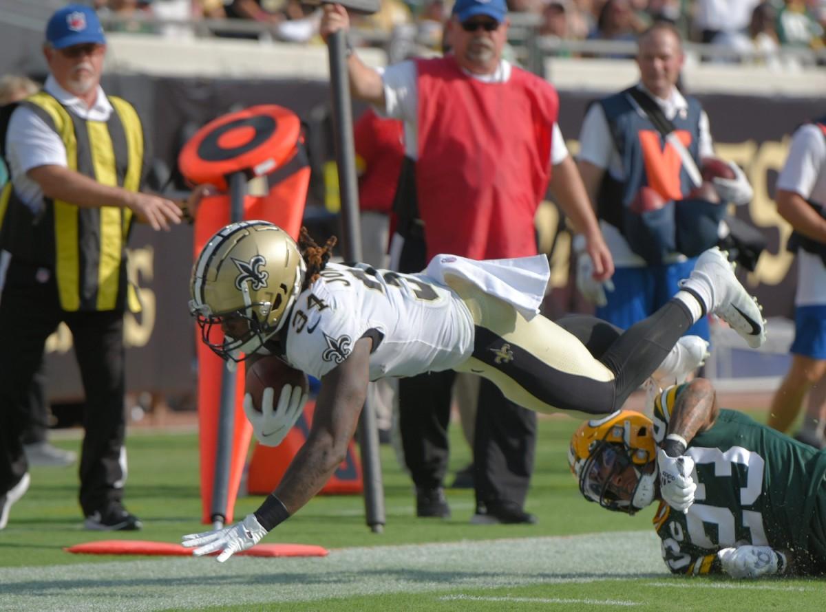 New Orleans Saints RB (34) Tony Jones Jr. dives over Green Bay cornerback Jaire Alexander (23)© Bob Self/Florida Times-Union via Imagn Content Services, LLC