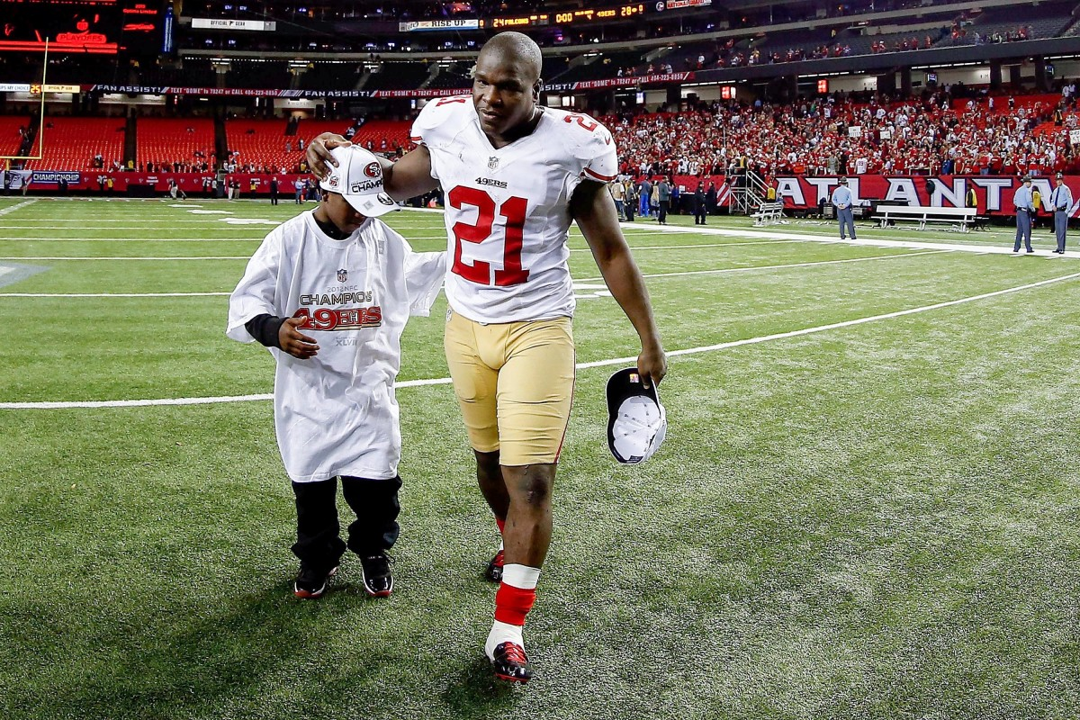 Gore Sr. and Gore Jr. in 2013 after the 49ers won the NFC championship game.