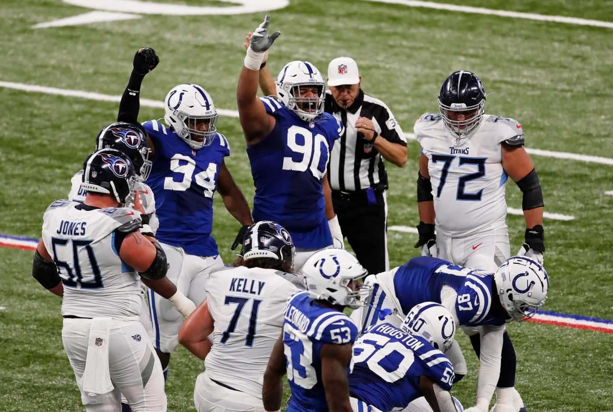 Indianapolis Colts defensive tackle Grover Stewart (90) and Indianapolis Colts defensive end Tyquan Lewis (94) yell in excitement after a possible turnover at Lucas Oil Stadium in Indianapolis, Sunday, Nov. 29, 2020. Tennessee Titans are leading after the first half, 35-14. Ini 1129 Colts Vs Titans