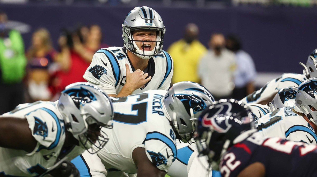 Sep 23, 2021; Houston, Texas, USA; Carolina Panthers quarterback Sam Darnold (14) calls a play at the line of scrimmage during the first quarter against the Houston Texans at NRG Stadium.