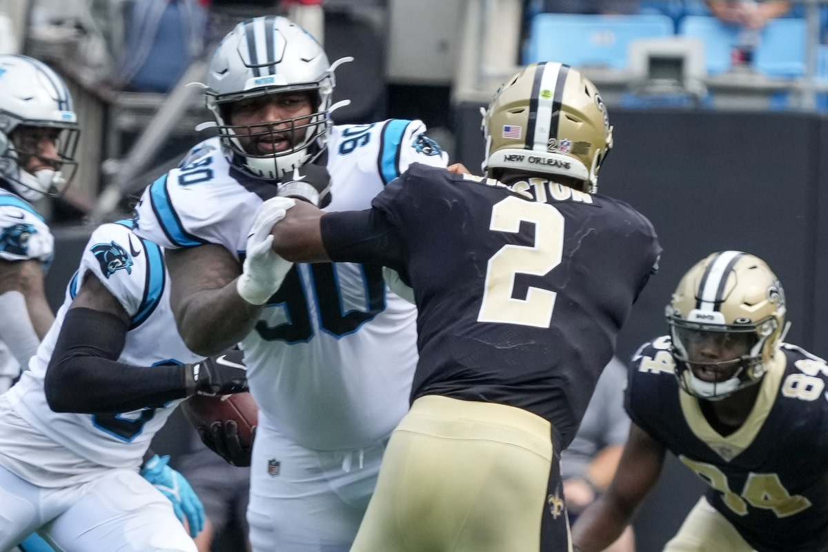 Sep 19, 2021; Charlotte, North Carolina, USA; Carolina Panthers defensive tackle DaQuan Jones (90) comes in to pressure New Orleans Saints quarterback Jameis Winston (2) during the second half at Bank of America Stadium. Mandatory Credit: Jim Dedmon-USA TODAY Sports