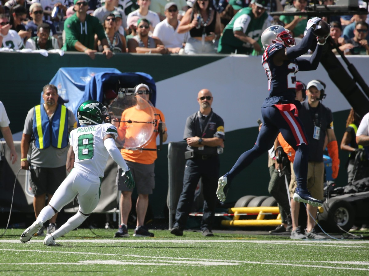 Intended receiver Elijah Moore of the Jets watches as J.C. Jackson of the Patriots intercepts a pass.Chris Pedota, NorthJersey.com via Imagn Content Services, LLC