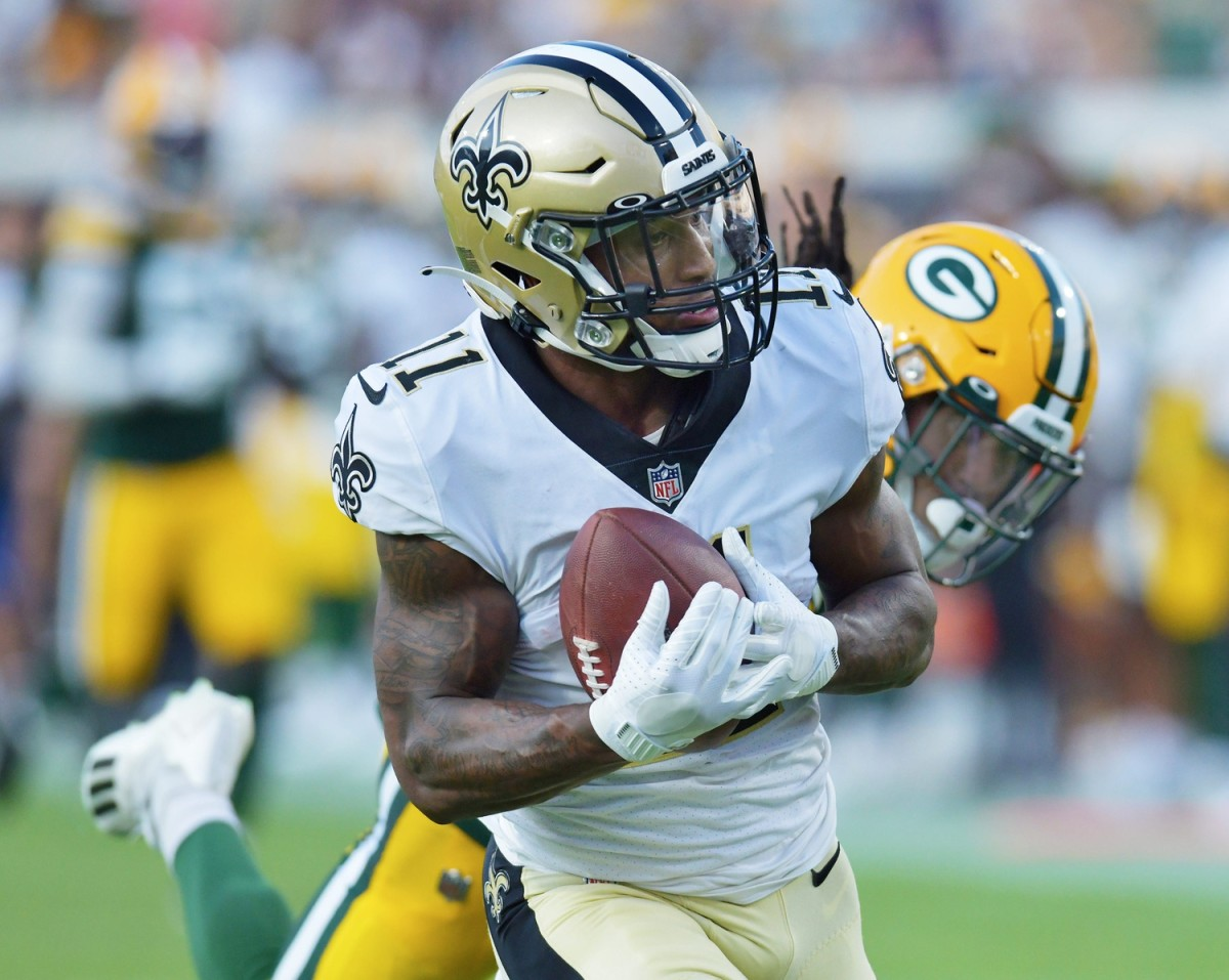 New Orleans Saints receiver Deonte Harris (11) pulls in a 55 yard touchdown pass from quarterback Jameis Winston (2) against the Packers.© Bob Self/Florida Times-Union via Imagn Content Services, LLC