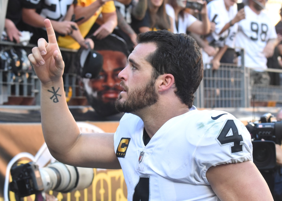 Sep 19, 2021; Pittsburgh, Pennsylvania, USA; Las Vegas Raiders quarterback Derek Carr leaves the field after defeating the Pittsburgh Steelers 26-17 at Heinz Field. Mandatory Credit: Philip G. Pavely-USA TODAY Sports