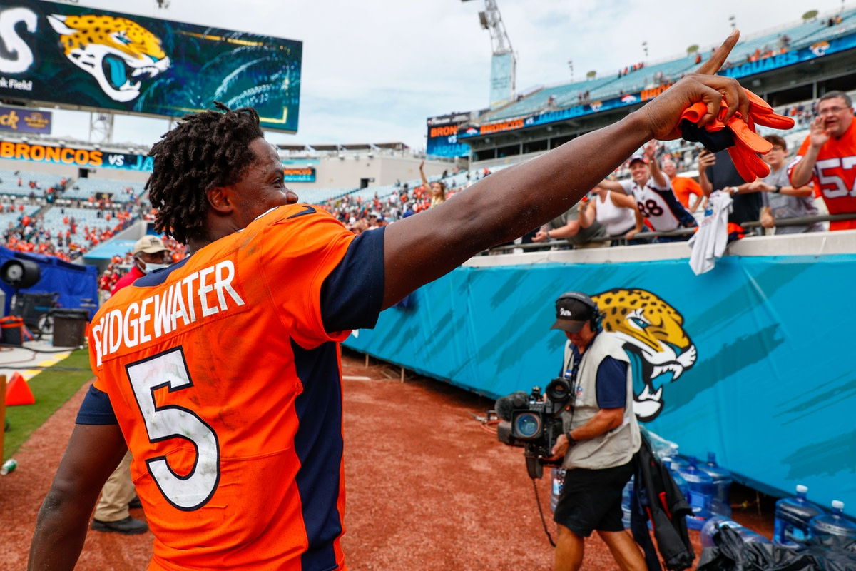 Sep 19, 2021; Jacksonville, Florida, USA; Denver Broncos quarterback Teddy Bridgewater (5) gestures to the fans after beating the Jacksonville Jaguars 23-13 at TIAA Bank Field. Mandatory Credit: Nathan Ray Seebeck-USA TODAY Sports