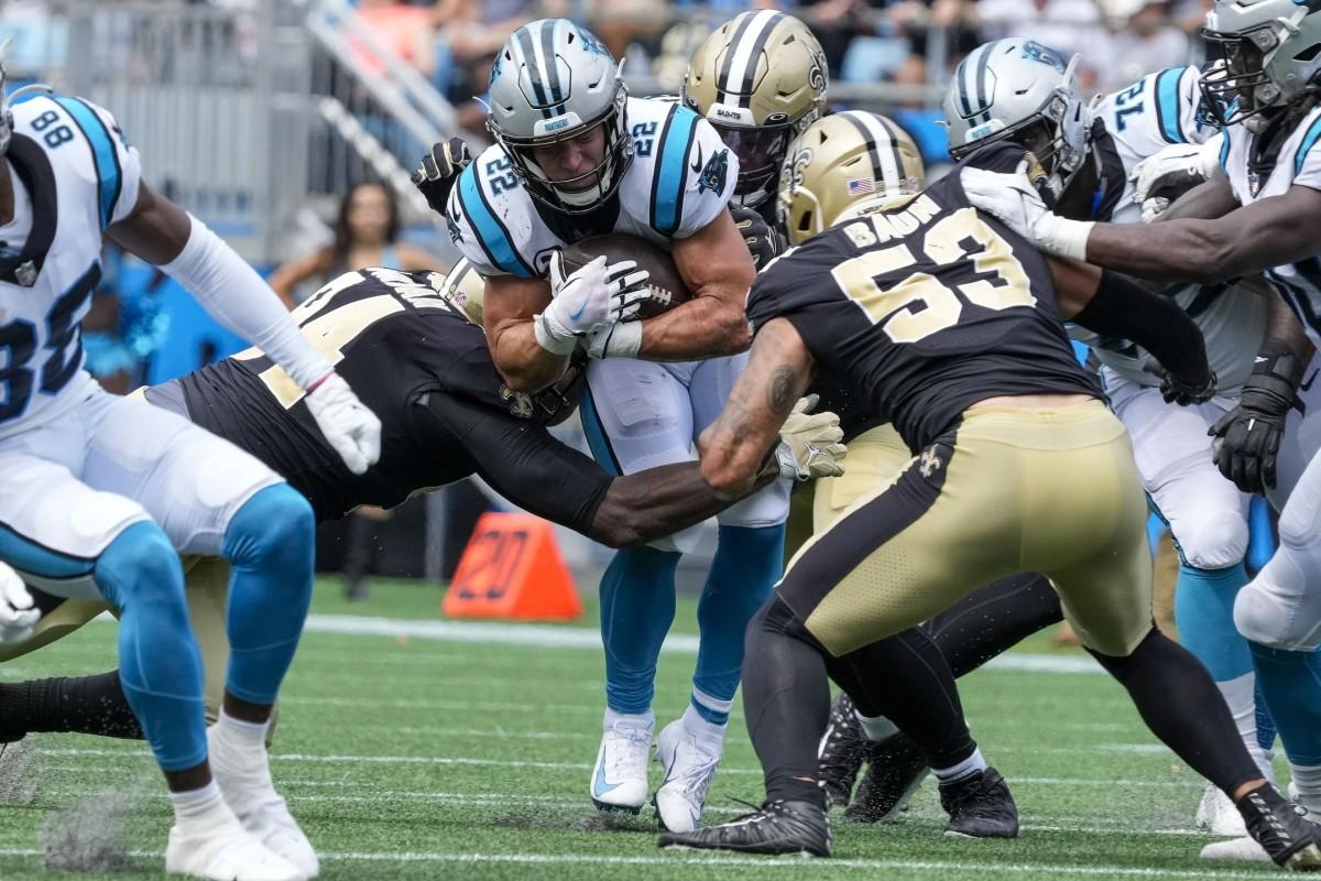 Carolina Panthers running back Christian McCaffrey (22) is tackled by the New Orleans Saints defense. Mandatory Credit: Jim Dedmon-USA TODAY Sports