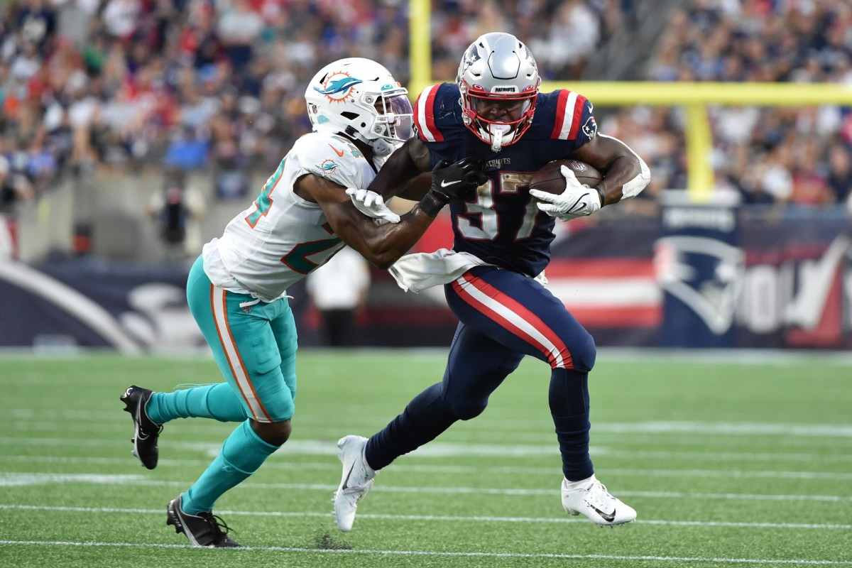 New England Patriots running back Damien Harris (37) runs the ball past Miami cornerback Byron Jones (24). Mandatory Credit: Bob DeChiara-USA TODAY Sports