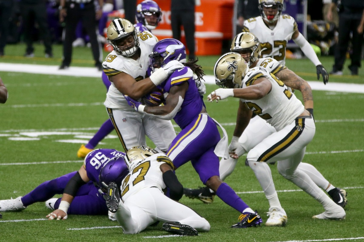 Minnesota Vikings running back Dalvin Cook (33) is tackled by New Orleans Saints defensive tackle Shy Tuttle (99) and safety Malcolm Jenkins (27). Mandatory Credit: Chuck Cook-USA TODAY Sports