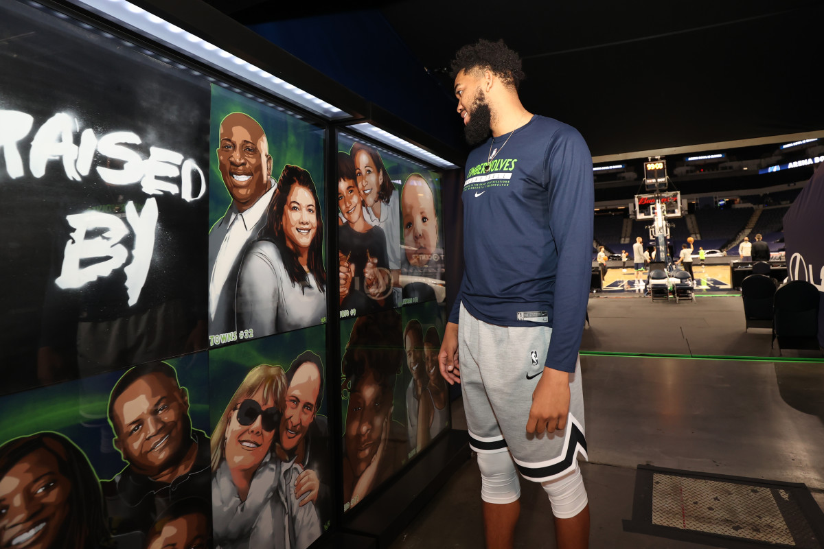 Karl-Anthony Towns looking at a mural