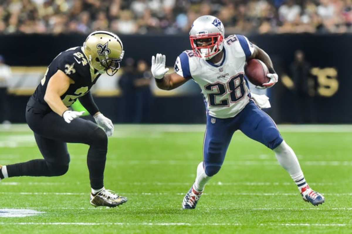 New England Patriots running back James White (28) runs the ball against the New Orleans Saints. Mandatory Credit: Scott Clause/The Advertiser via USA TODAY Sports