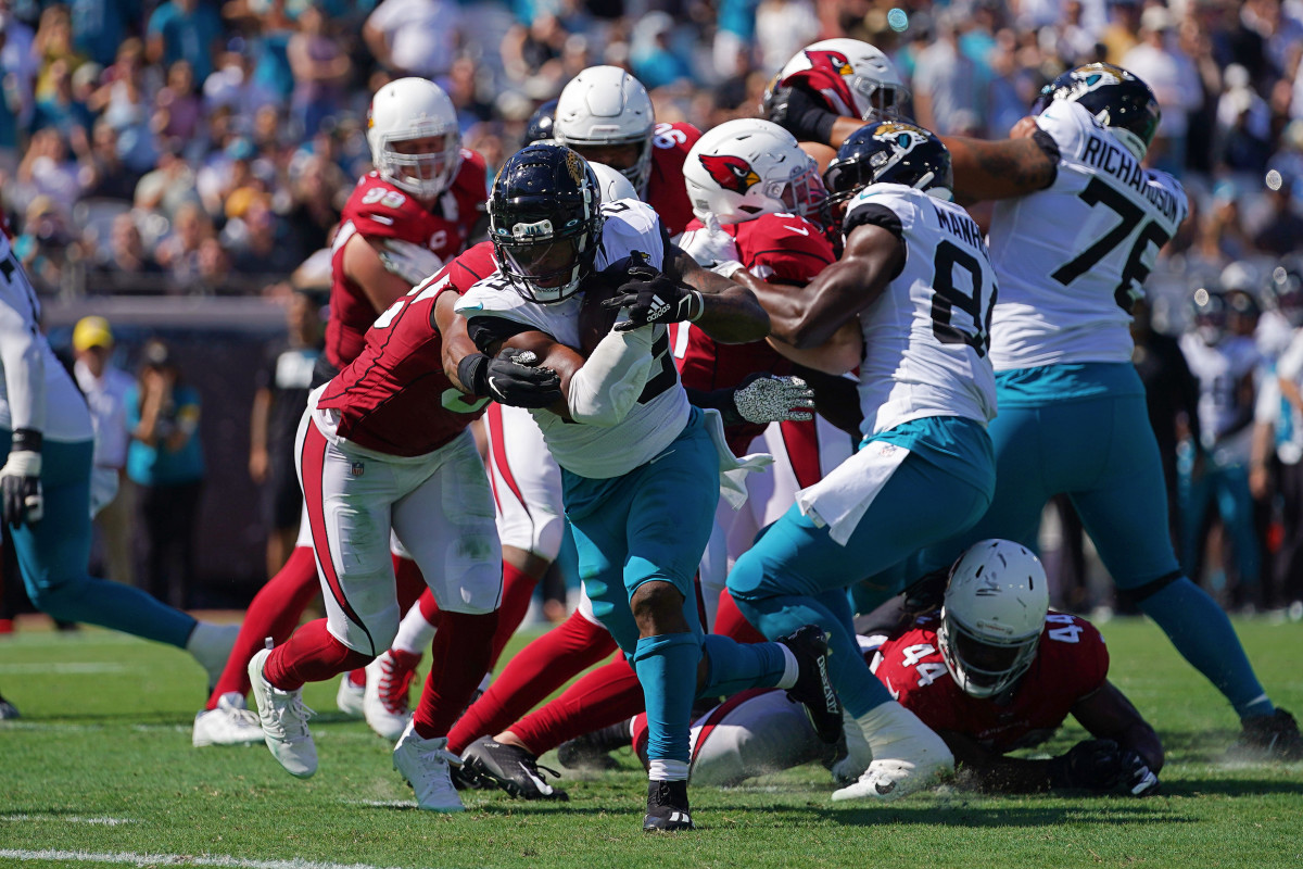 Jacksonville Jaguars running back James Robinson (25) runs for a touchdown during the second half against the Arizona Cardinals at TIAA Bank Field. Mandatory Credit: Jasen Vinlove-USA TODAY Sports