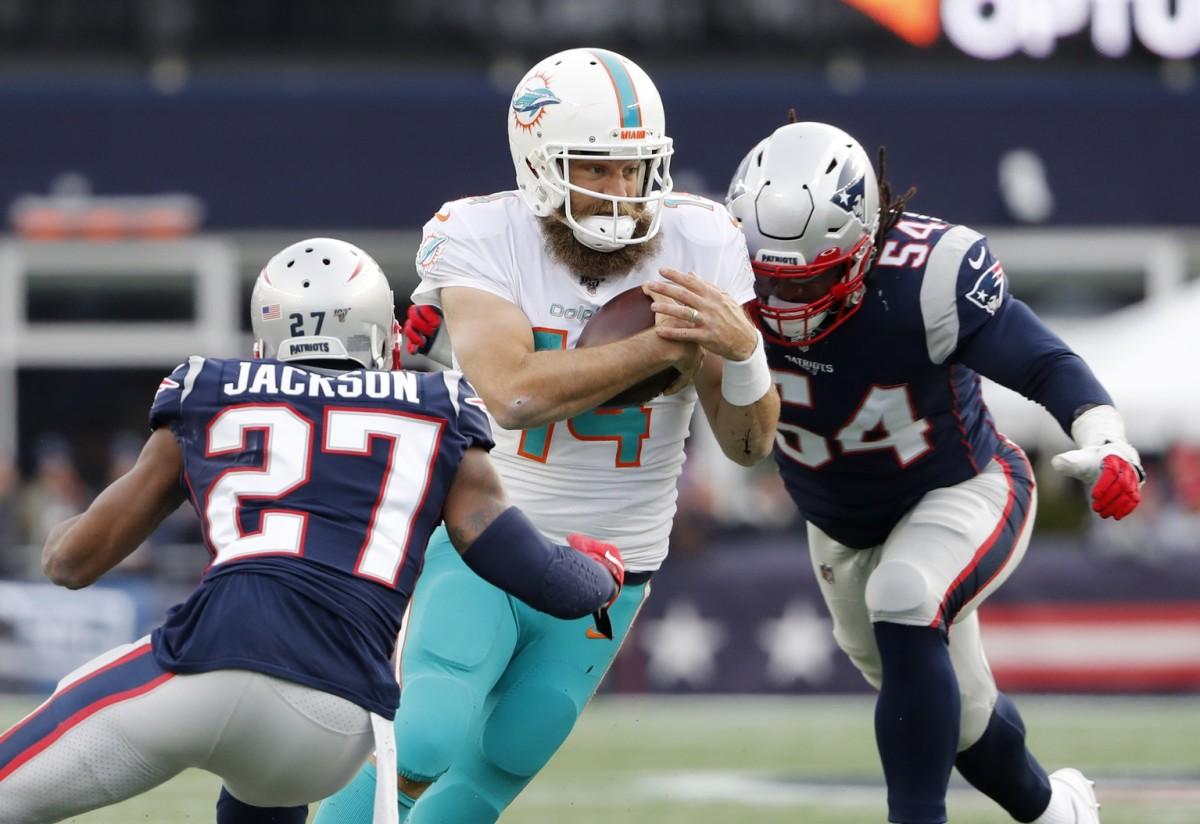 Miami quarterback Ryan Fitzpatrick (14) tries to cut between New England Patriots cornerback J.C. Jackson (27) and linebacker Dont'a Hightower. Mandatory Credit: Winslow Townson-USA TODAY