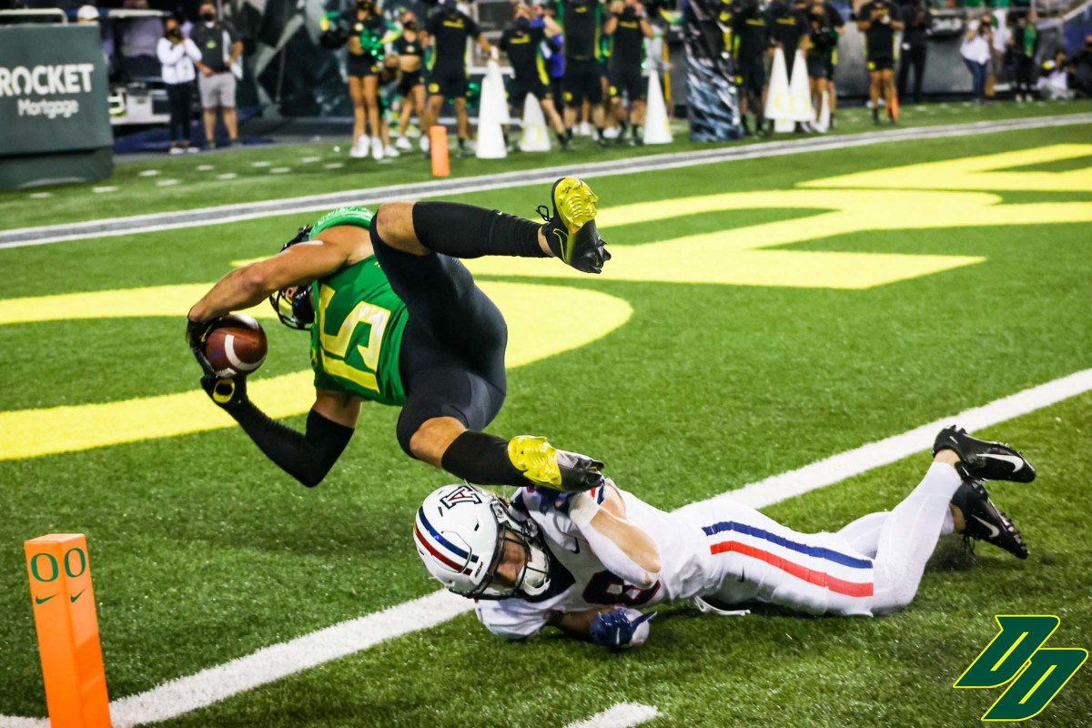 Williams dives into the end zone to cap off a 68-yard interception return late in the fourth quarter.