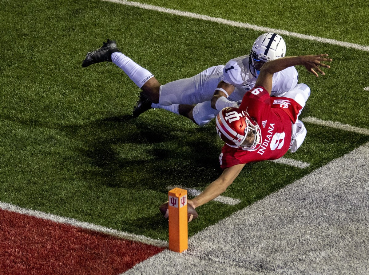 Indiana quarterback Michael Penix Jr. reaches for the pylon on an overtime 2-point conversion vs. Penn State in 2020. (Marc Lebryk/USA Today Sports)