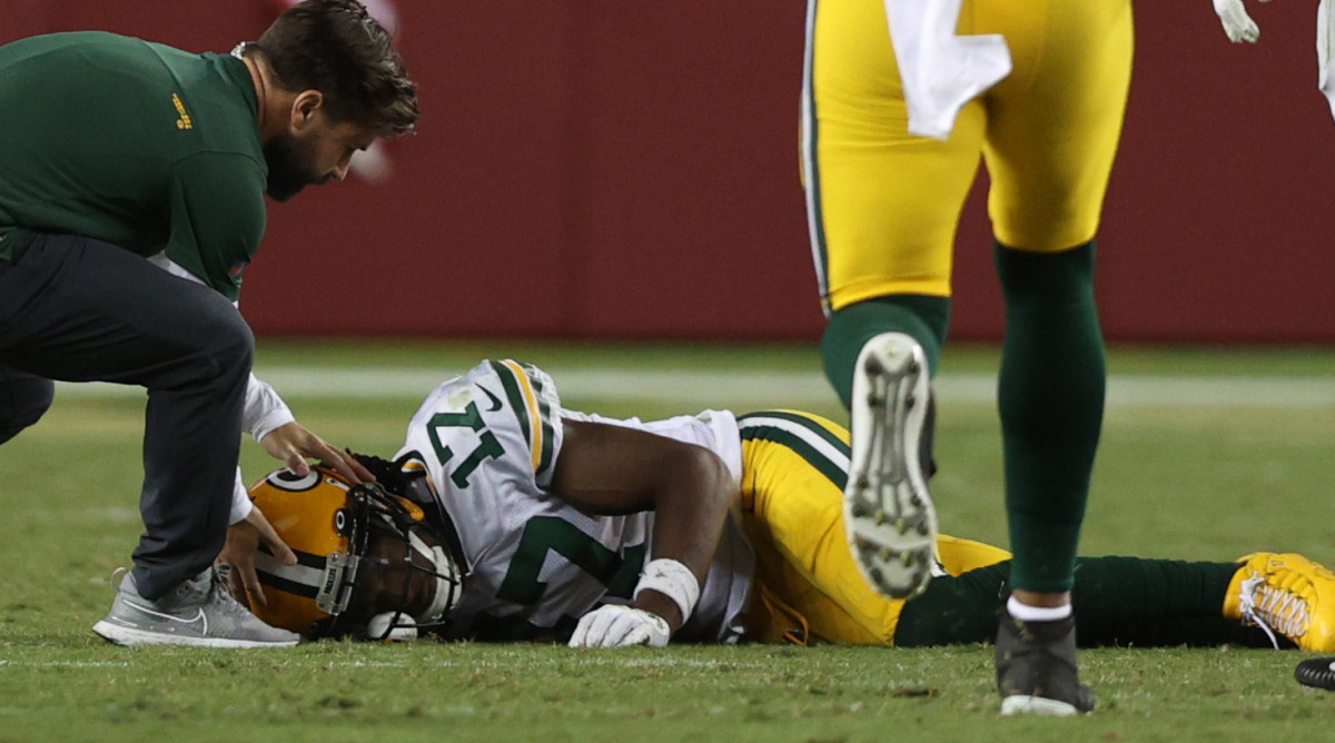 Davante Adams #17 of the Green Bay Packers is injured trying to catch a pass during the fourth quarter against the San Francisco 49ers in the game at Levi's Stadium on September 26, 2021 in Santa Clara, California.