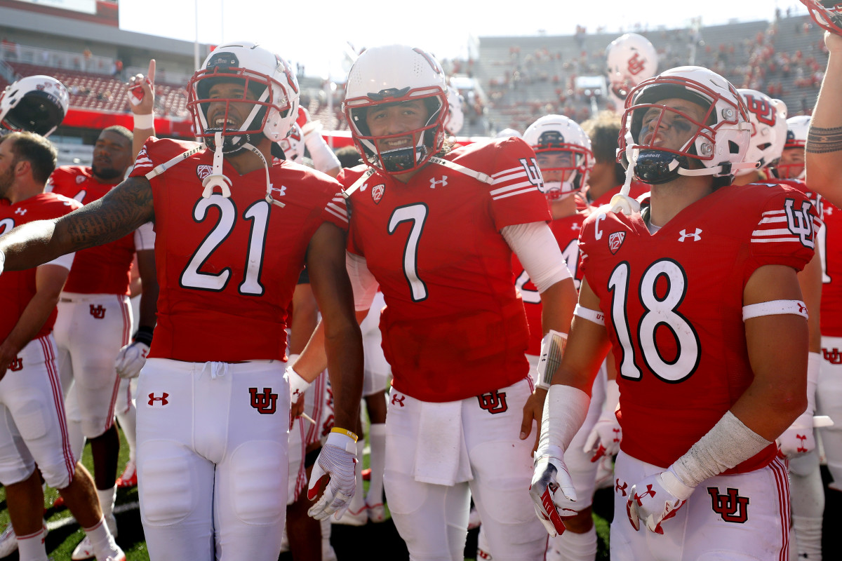 Utah Utes quarterback Cameron Rising (7), center, celebrates with his teammates after their win against the Washington State Cougars.