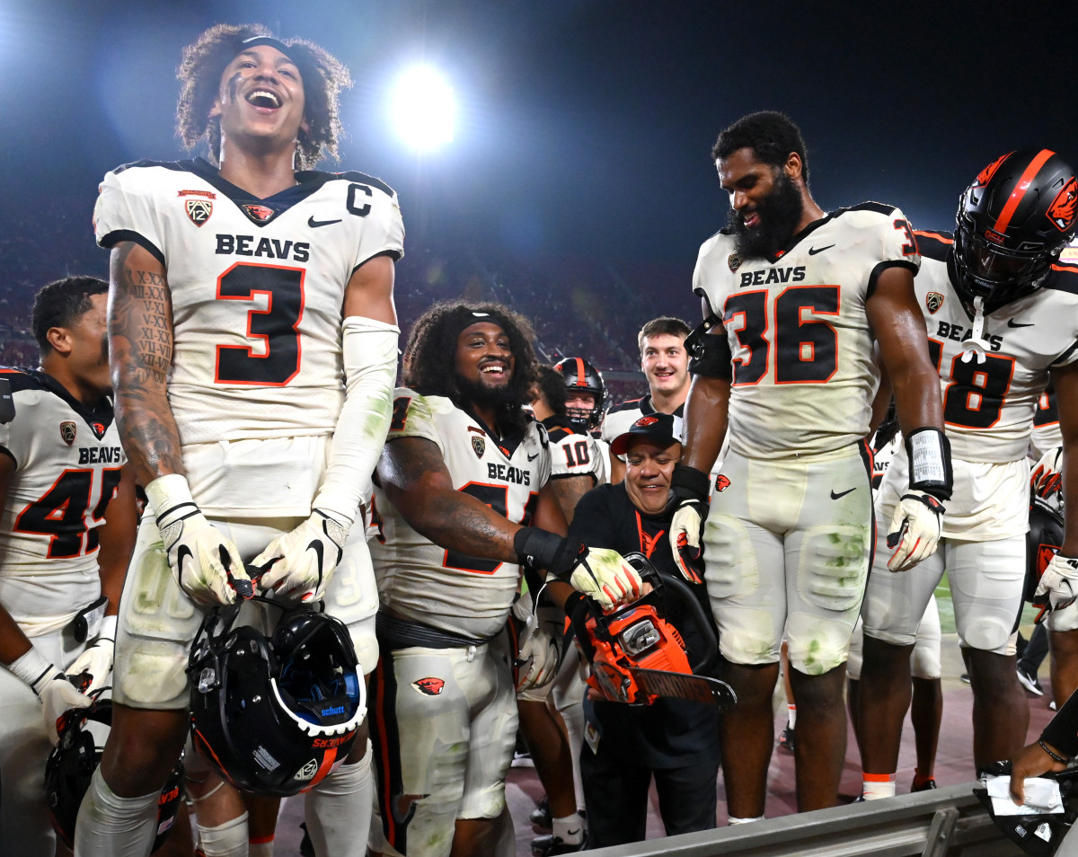 Oregon State Beavers celebrate with fans after defeating the USC Trojans.