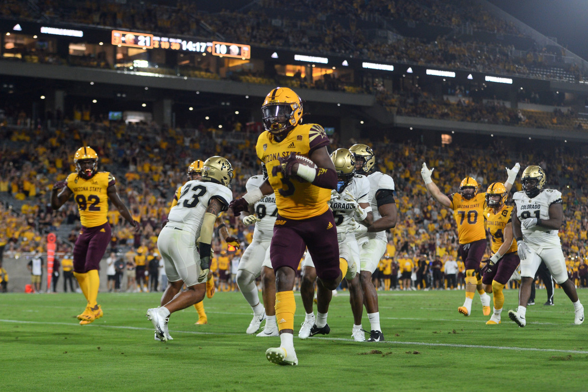 Arizona State Sun Devils running back Rachaad White (3) scores a touchdown against the Colorado Buffaloes.