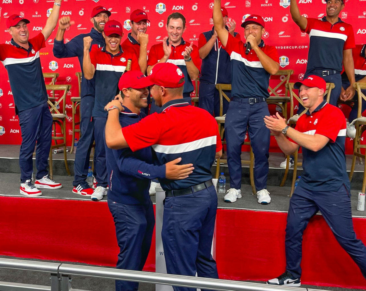 Brooks Koepka and Bryson DeChambeau hug at out at the Ryder Cup.