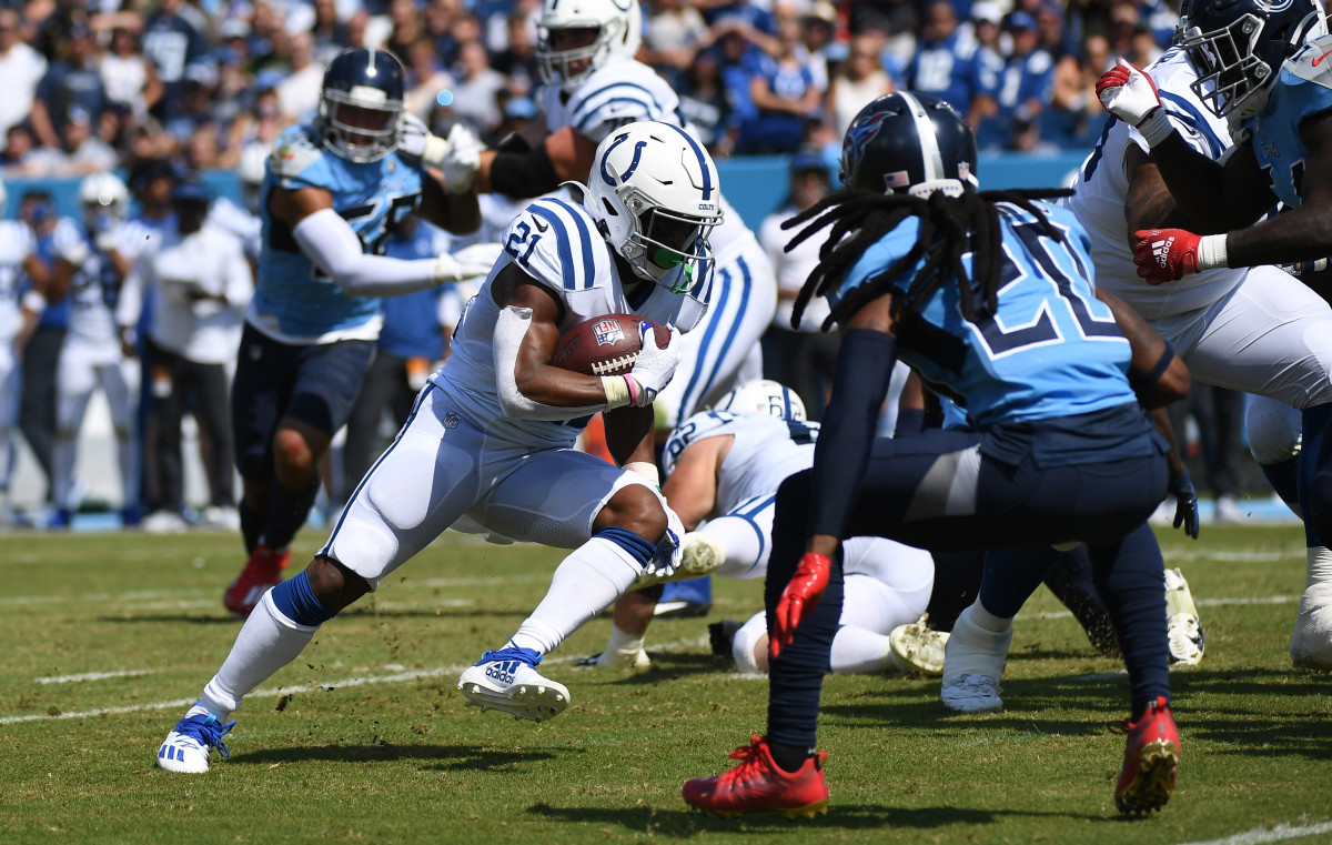 Sep 26, 2021; Nashville, Tennessee, USA; Indianapolis Colts running back Nyheim Hines (21) runs for a first down during the first half against the Tennessee Titans at Nissan Stadium.