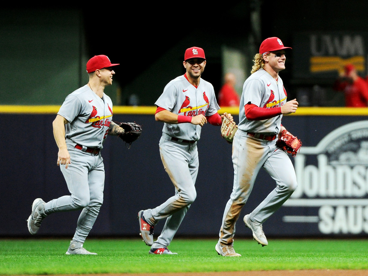 Sep 20, 2021; Milwaukee, Wisconsin, USA;  St. Louis Cardinals left fielder Tyler O'Neill (27) and right fielder Dylan Carlson (3) and center fielder Harrison Bader (48) celebrate after defeating the Milwaukee Brewers at American Family Field.