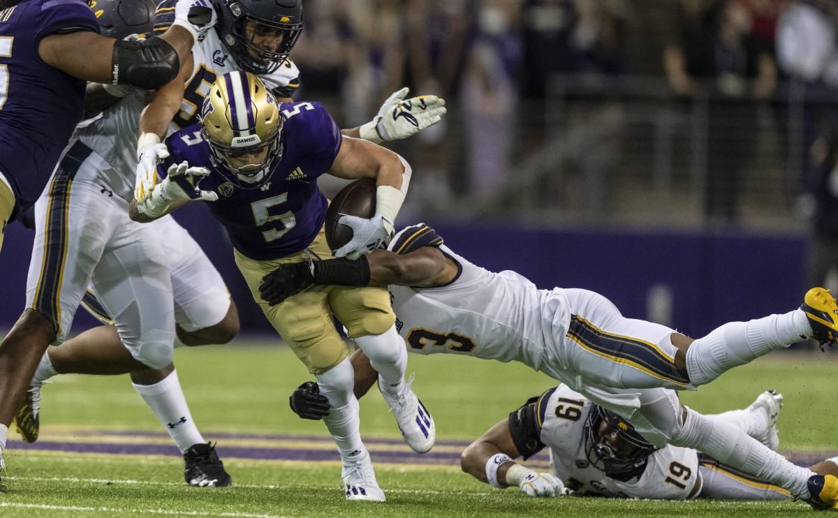 Sean McGrew runs through the Cal defense.