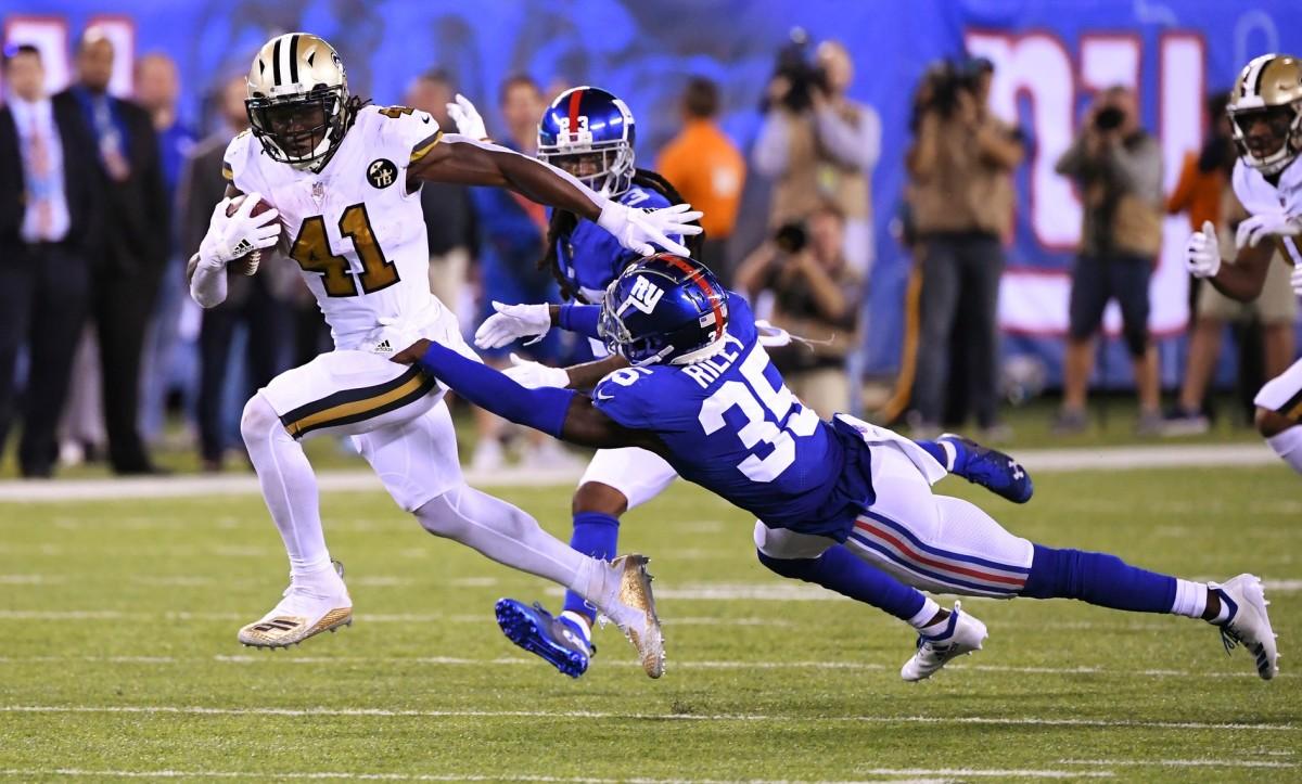 Sep 30, 2018; New Orleans Saints running back Alvin Kamara (41) runs past New York Giants cornerback Curtis Riley (35) for a touchdown during the 4th quarter. Mandatory Credit: Robert Deutsch-USA TODAY Sports