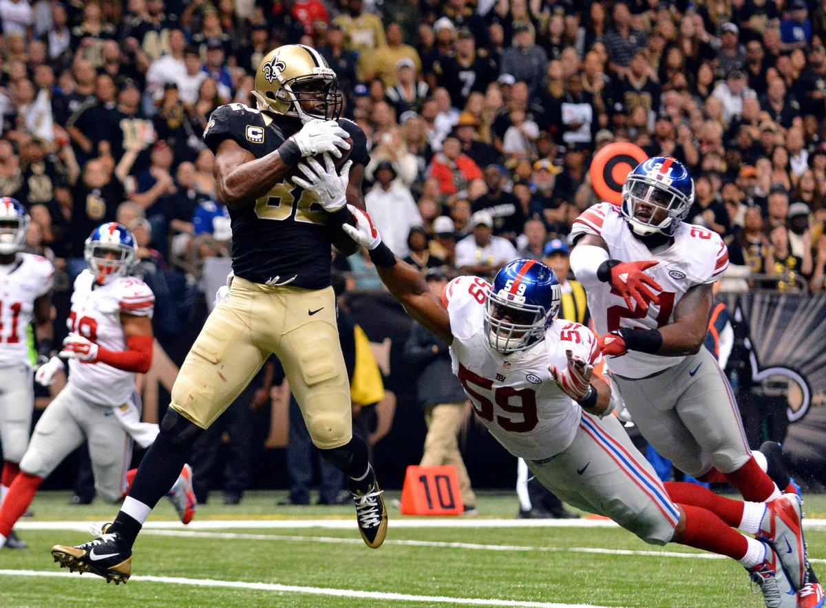 Former New Orleans Saints TE Ben Watson (82) catches a touchdown pass from QB Drew Brees in a 2015 victory against the Giants. Credit: New York Times