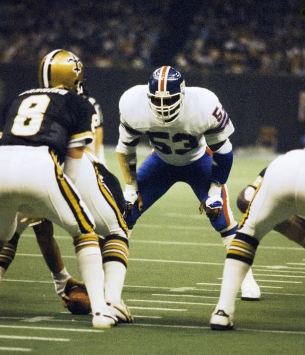 New York Giants LB Harry Carson (53) eyes up New Orleans Saints QB Archie Manning (8) during a 1978 game. Credit: nfl.com