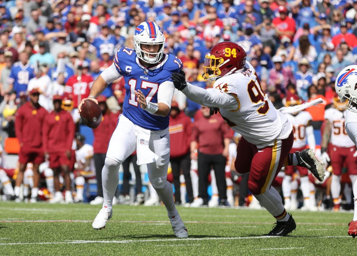 Bills quarterback Josh Allen slips away from Washington's Daron Payne.