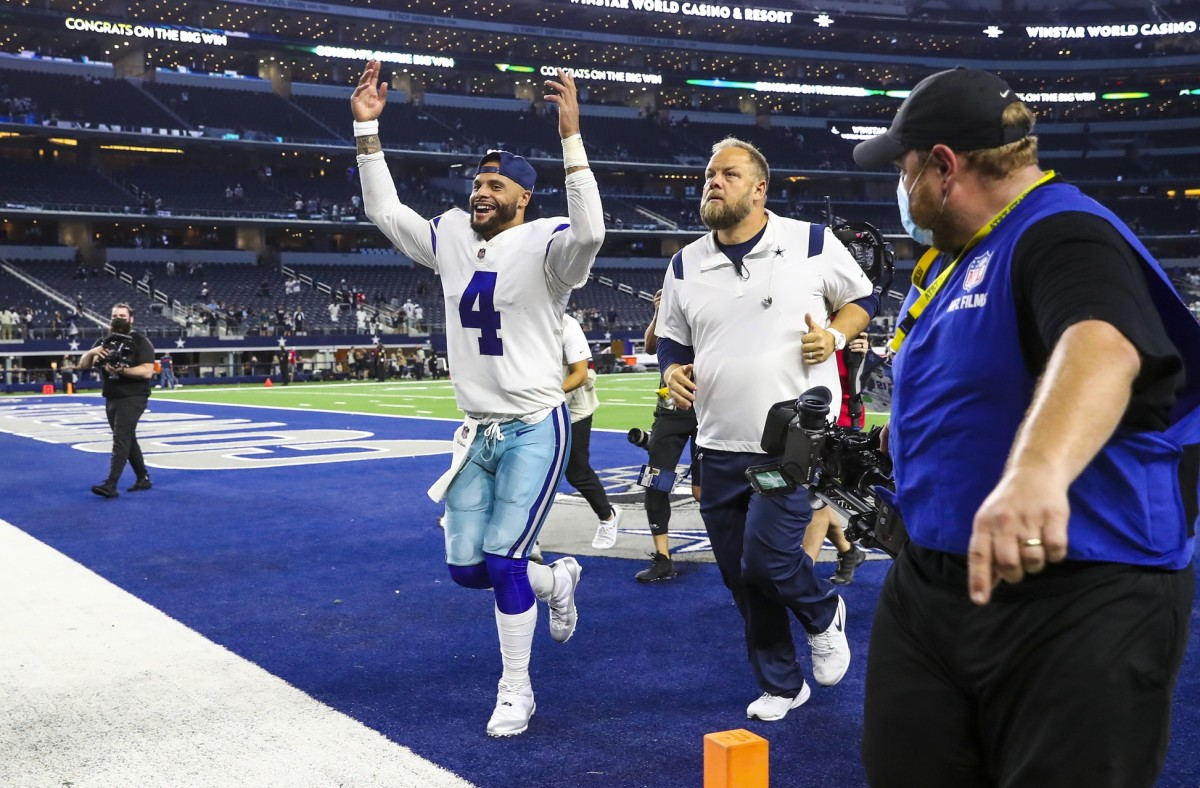 Sep 27, 2021; Arlington, Texas, USA; Dallas Cowboys quarterback Dak Prescott (4) celebrates the win against the Philadelphia Eagles at AT&T Stadium.