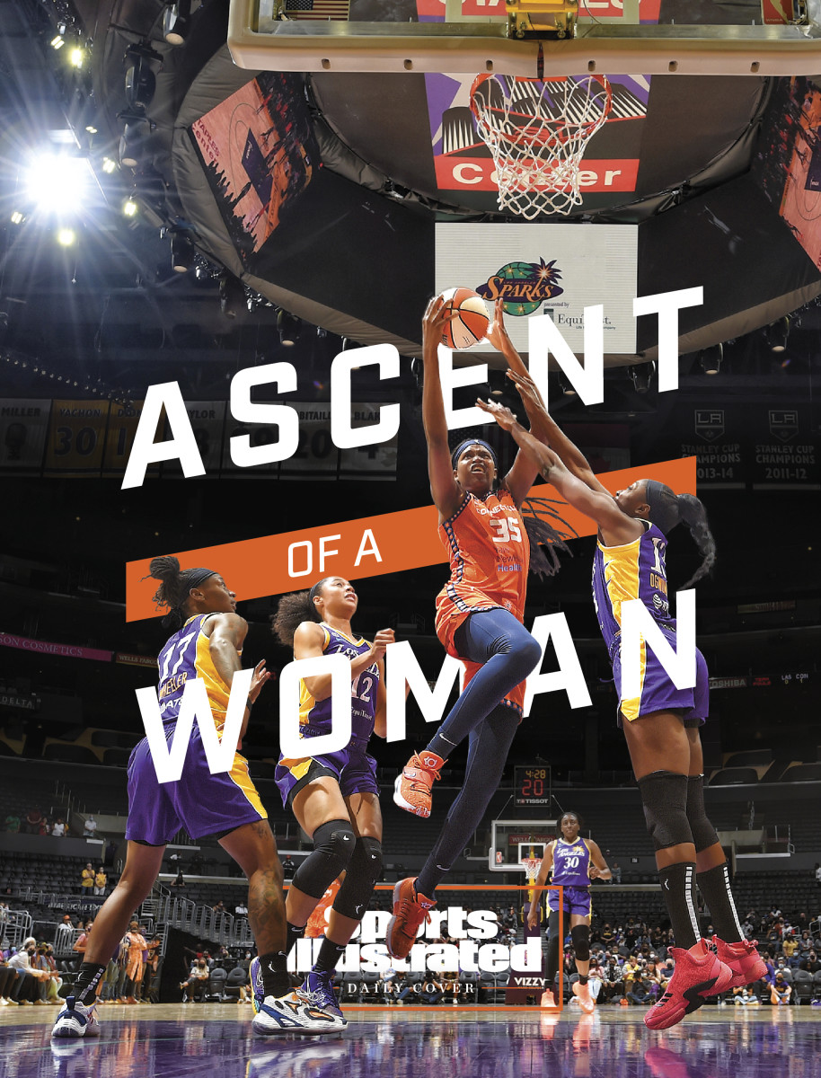 Jonquel Jones driving to the basket with the words Ascent of a Woman