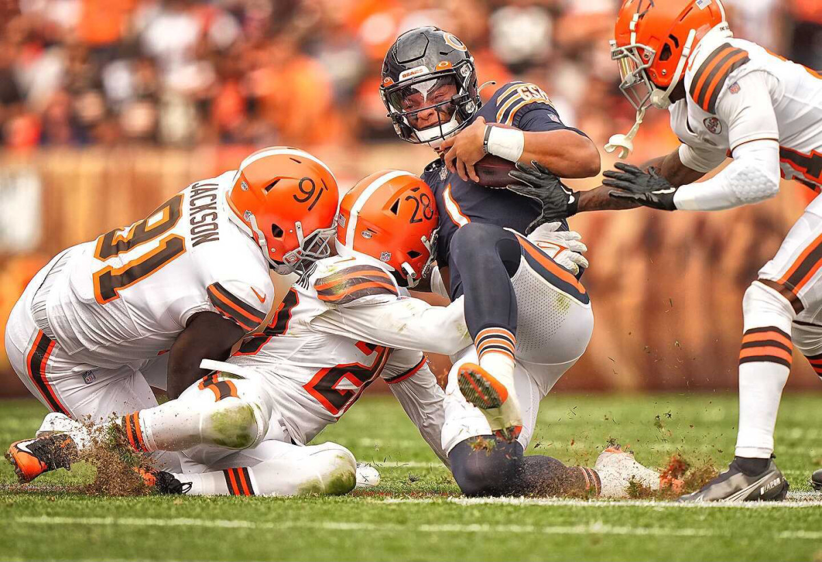 Justin Fields slides down during a game against the Browns