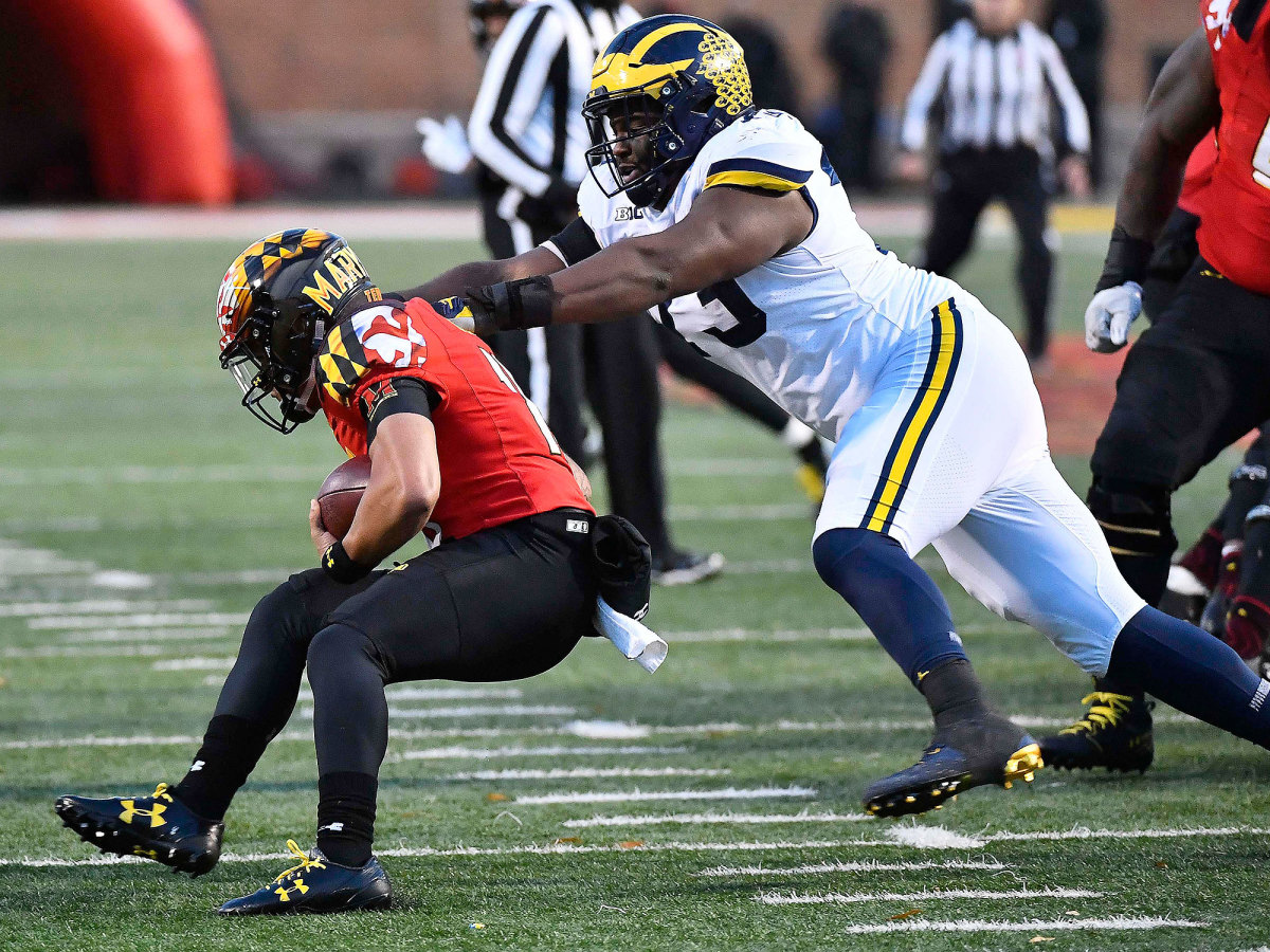 Maryland QB Ryan Brand is tackled by Michigan in 2017