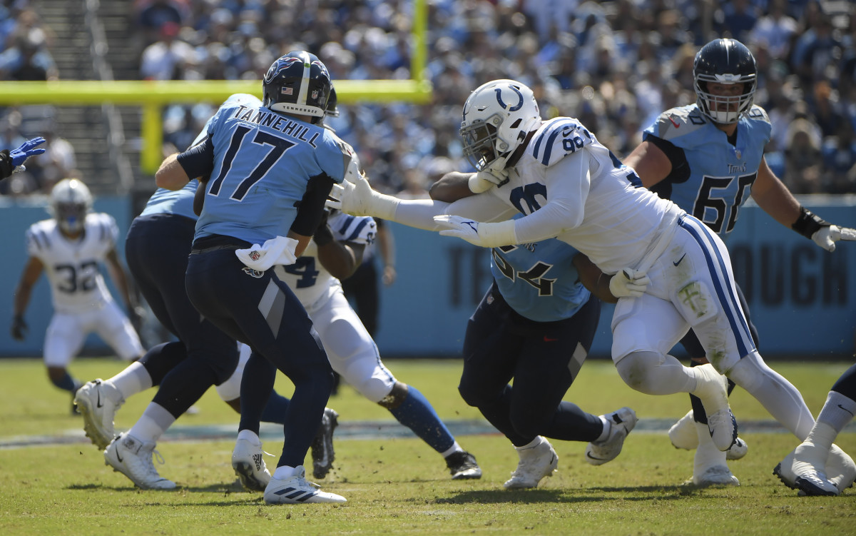 Sep 26, 2021; Nashville, Tennessee, USA; Indianapolis Colts defensive tackle DeForest Buckner (99) pressures Tennessee Titans quarterback Ryan Tannehill (17) during the first half at Nissan Stadium. Mandatory Credit: Steve Roberts-USA TODAY Sports