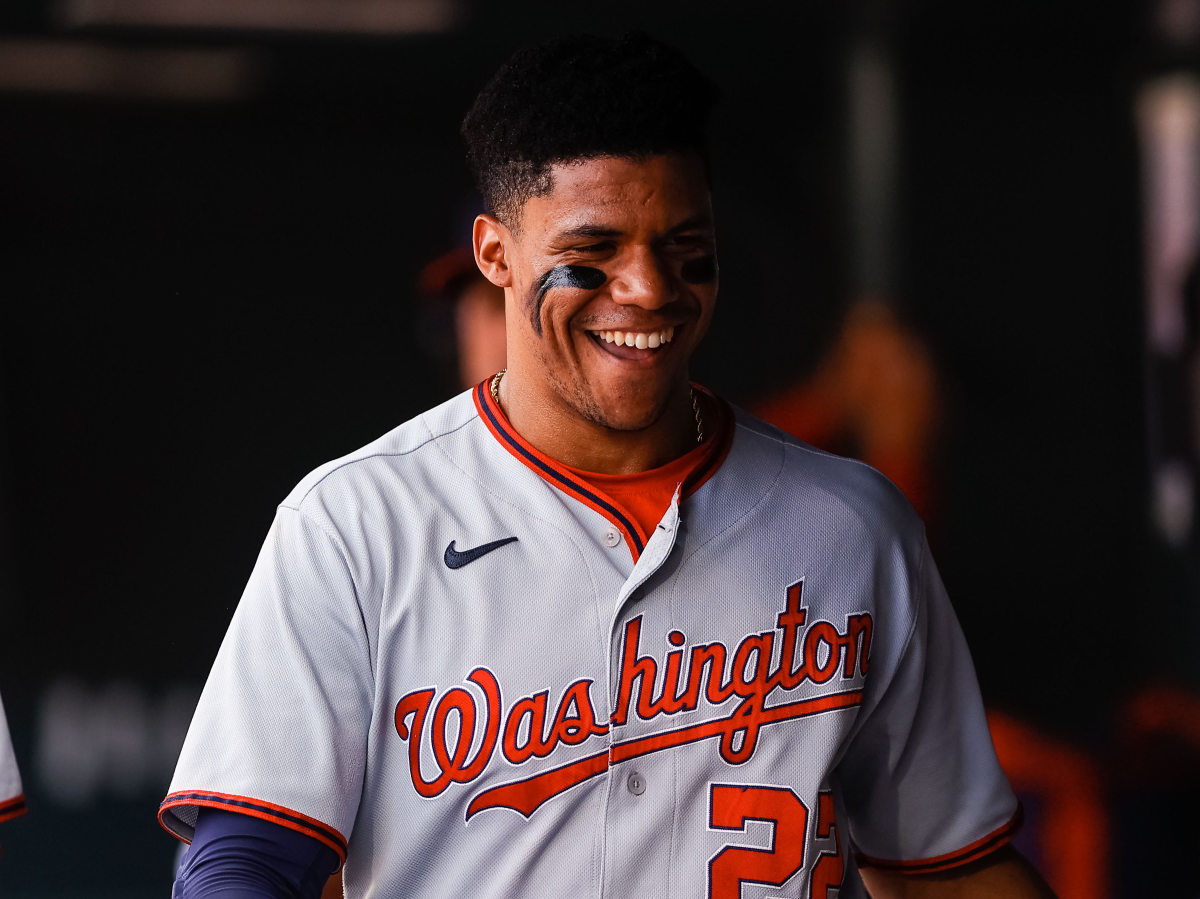 Washington Nationals right fielder Juan Soto (22) in the dugout in the first inning against the Colorado Rockies at Coors Field.