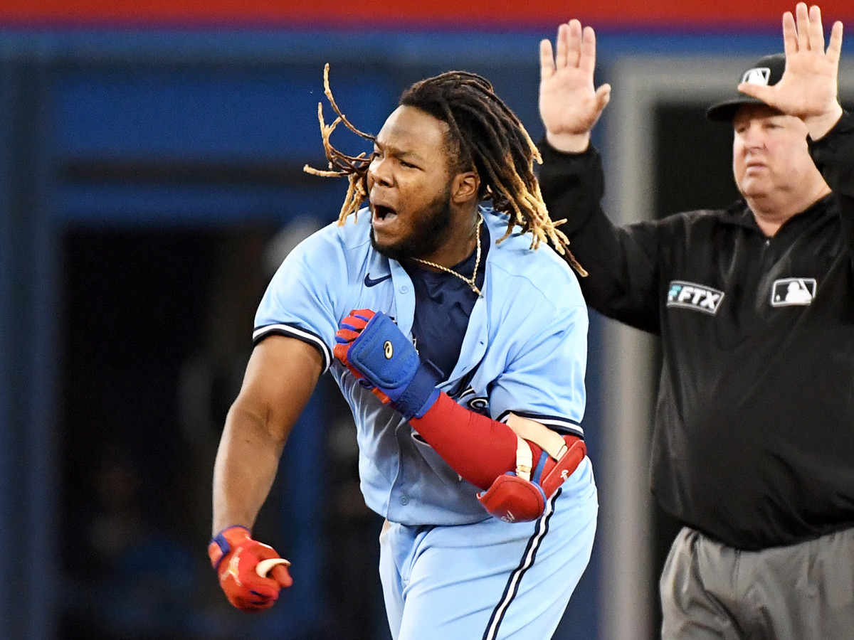 Sep 29, 2021; Toronto, Ontario, CAN; Toronto Blue Jays first baseman Vladimir Guererro Jr. (27) reacts after hitting an RBI double against New York Yankees in the fifth inning at Rogers Centre.