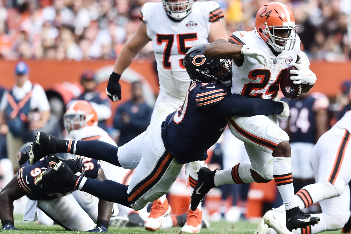Sep 26, 2021; Cleveland, Ohio, USA; Chicago Bears defensive end Angelo Blackson (90) tackles Cleveland Browns running back Nick Chubb (24) during the second half at FirstEnergy Stadium. Mandatory Credit: Ken Blaze-USA TODAY Sports