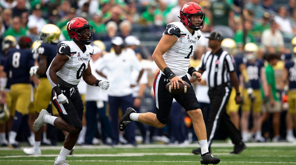 Cincinnati Bearcats linebacker Wilson Huber (2) carries the ball while celebrating recovering a fumble on a kick off in the first half of the NCAA football game between the Cincinnati Bearcats and the Notre Dame Fighting Irish on Saturday, Oct. 2, 2021, at Notre Dame Stadium in South Bend, Ind.