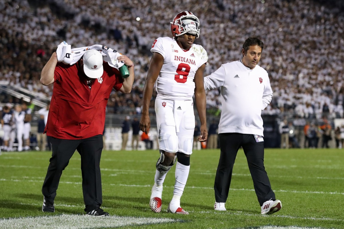 Indiana quarterback Michael Penix Jr. is helped off the field after suffering a shoulder injury Saturday night at Penn State. (USA TODAY Sports)