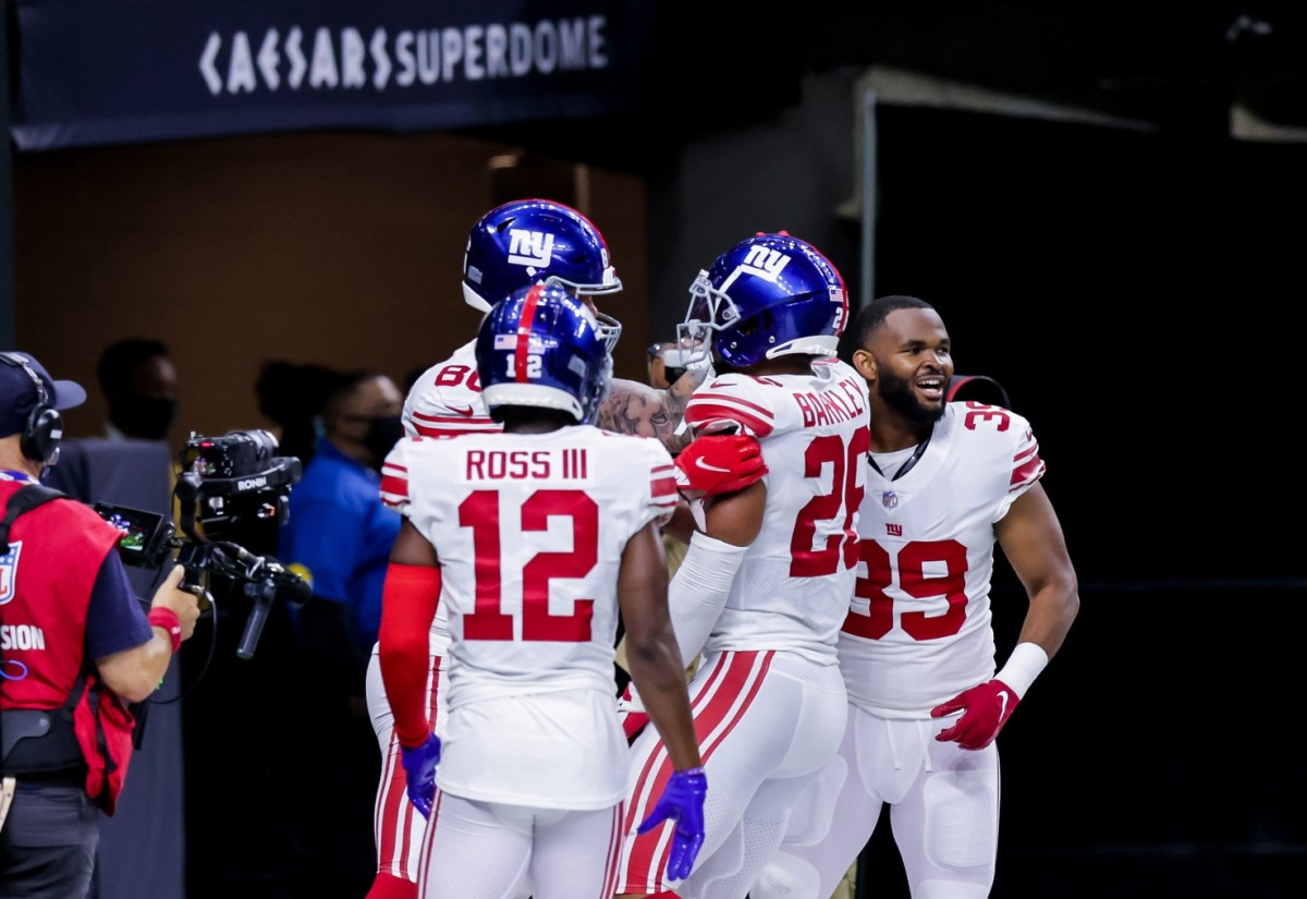 Oct 3, 2021; New Orleans, Louisiana, USA; New York Giants running back Saquon Barkley (26) reacts to scoring the winning touchdown against the New Orleans Saints in overtime at Caesars Superdome.