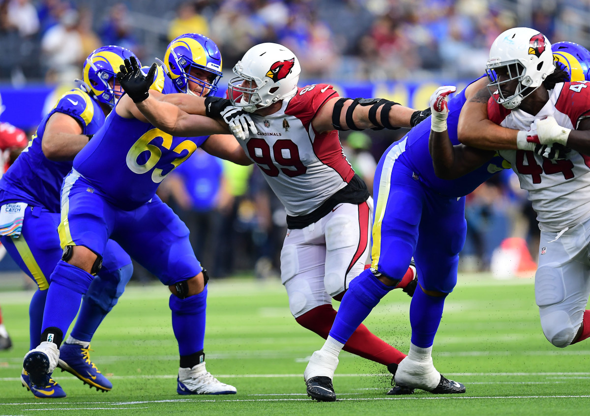 Oct 3, 2021; Inglewood, California, USA; Arizona Cardinals defensive end J.J. Watt (99) works against Los Angeles Rams offensive guard Austin Corbett (63) during the second half at SoFi Stadium. Mandatory Credit: Gary A. Vasquez-USA TODAY Sports
