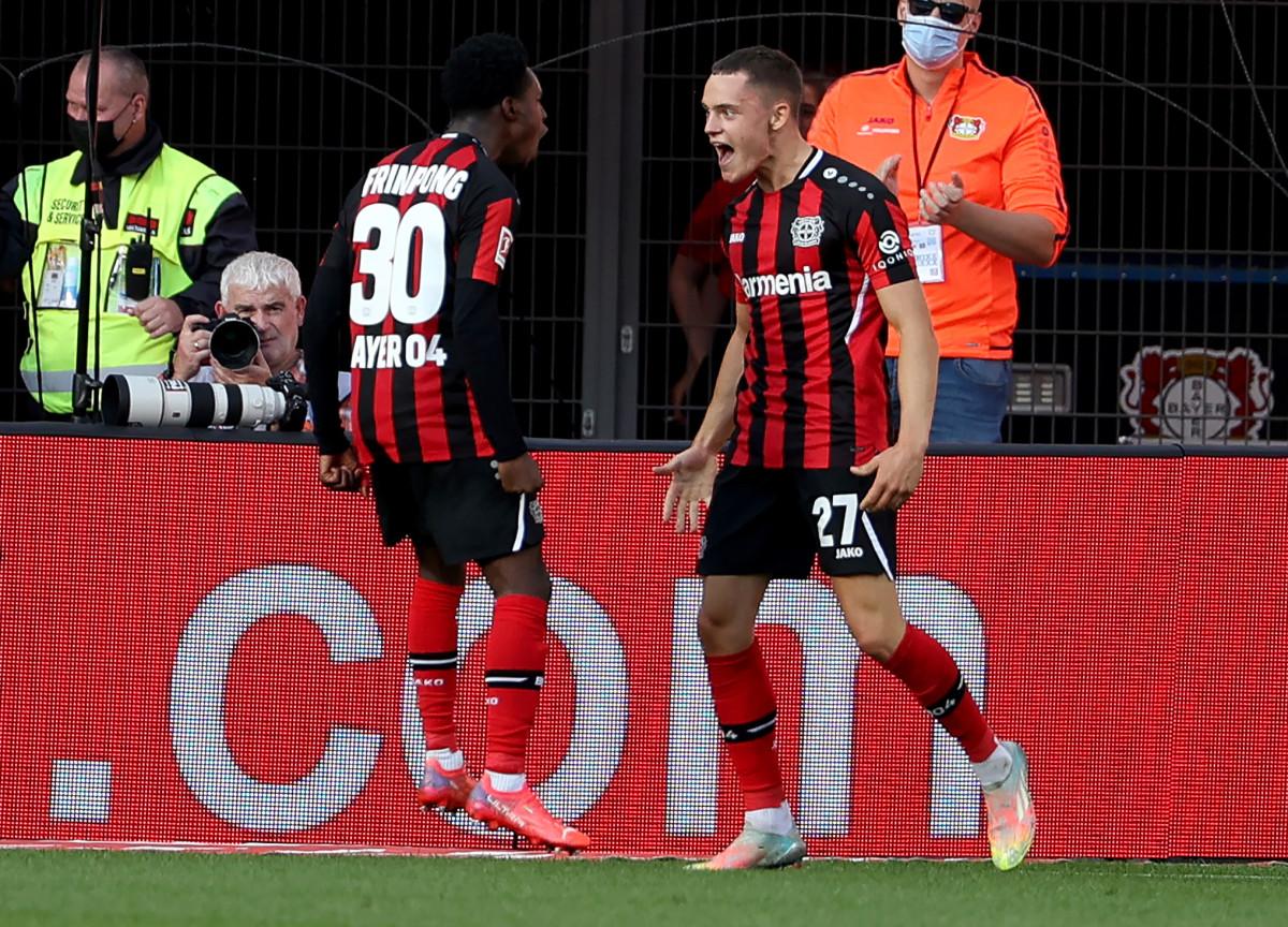 Wirtz celebrates scoring against Mainz with Jeremie Frimpong.
