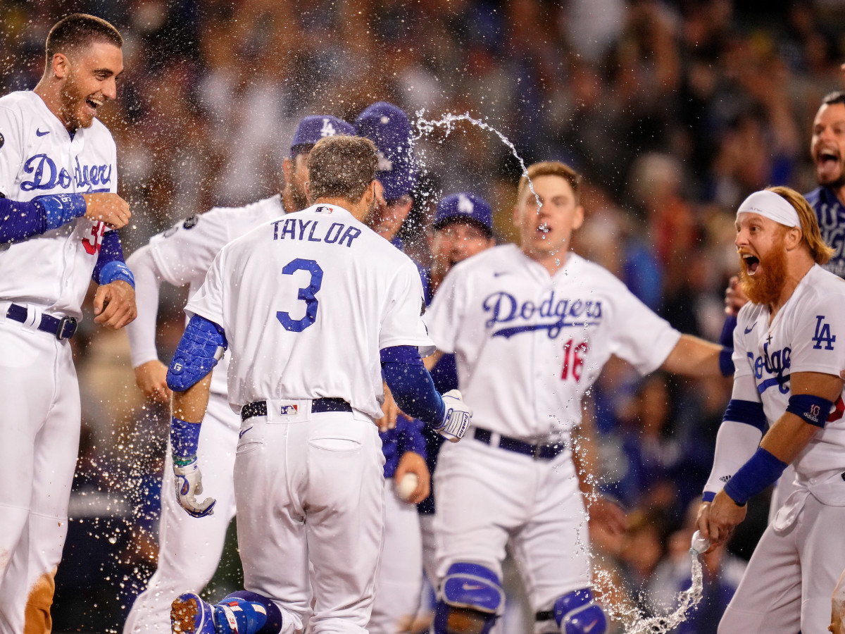 The Los Angeles Dodgers celebrate the walk-off two run home run hit by left fielder Chris Taylor (3) against the St. Louis Cardinals during the ninth inning at Dodger Stadium. The Los Angeles Dodgers